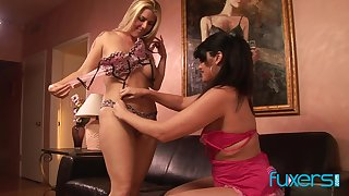 Lesbian cougar with babe having some serious lesbain strapon sex