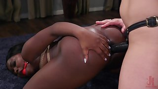 Thick ebony loves a bit of lesbian strap-on action